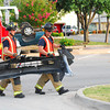 Norman firefighters remove debris from the roadway after a two-vehicle accident on Peters Ave. and Grey Street Saturday evening that  left one car upside down.  No one was injured in the accident.<br /> Kyle Phillips/The Transcript