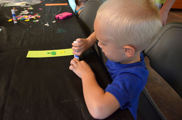 Mason Rogers, 5,  designs his bird-themed bookmark Saturday afternoon during  Bird Day at Discovery Cove Nature Center. <br /> Kyle Phillips/The Transcript