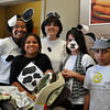 Tori Collier, Bailey Collier, 8, daughter of Tori Collier, Renae Harris, Kelley, 10, daughter of Renae Harris, Bryce Collier, 10, son of Tori Collier in stroller Cannon Collier, 4 months, son of Tori Collier dresses like cows during Chick-fil-a's Cow Appreciation Day on Friday. Customers who come in costume as a cow can get a free meal. Julie Bragg/ The Transcript