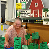 Charlene Perry organizes her peppers at her booth during the Farmers Market on Saturday. Julie Bragg/ The Transcript