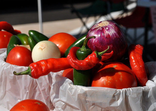 Peppers, onions, tomatoes, and potatoes are some of the popular produce that are sold at the Cleveland County Farmer Market. The Farmer Market is held Monday and Wednesdays from 9 to noon at the Cleveland County Fairgrounds. Julie Bragg/ The Transcript