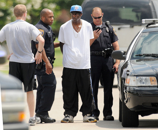 Norman police detain a suspect  Friday, June 22, 2012, in a residential burglary in the Berkeley Addition in west Norman.   Jerry Laizure / The Transcript