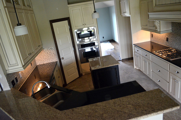 The kitchen in the home at 3109 24th Avenue Southeast is equiped with granite countertops opening up to a fanily room and breakfast room.  The house will be one that is featured in the 2012 Festival of homes.<br /> Kyle Phillips/The Transcript
