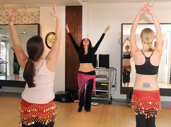 Belly dancing instructor Marjan Esaa takes students Jessica Grieshaber (left) and Carla Winters through their routine a tSonder Music, Dance and Art studio.