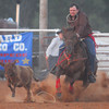 A calf gets away from cowboy Hank Reynolds Saturday night during the calf roping competition at the Norman Round Up Club's Rodeo.<br /> Kyle Phillips/The Transcript