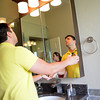 Kellen Powell checks out the mirrirs in the bathroom at the Festival Show Home at the Festival of Homes Saturday afternoon.<br /> Kyle Phillips/The Transcript