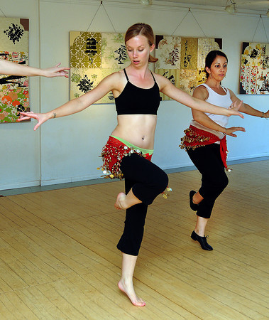 Belly dacning students Jessica Grieshaber (left) and Carla Winters go through their routine atSonder Music, Dance and Art studio.