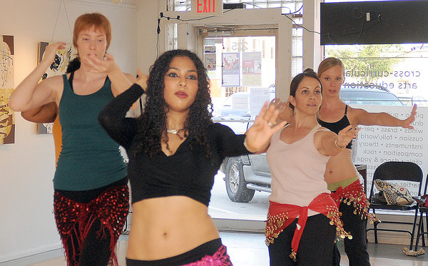 Belly dancing instructor Marjan Esaa leads  students (from left) Natasha Germany, Carla Winters and Jessica Grieshaber through their routine a tSonder Music, Dance and Art studio.