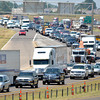 Interstate 35 in Norman turns into a parking lot Friday afternoon as northbound and southbound traffic had to be narrowed to one lane at the Goldsby exit after an accident involving an overturned semi.  Both north and southbound lanes of  I-35 were reopened before 2:30 p.m. Friday.<br /> Kyle Phillips/The Transcript
