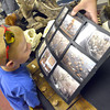 Ryan Mitchell, 7, looks at pictures from the Museum of Osteology Friday afternoon during the Norman Public Library's Summer Read Program.  During the event community organizations explained activities they have available for children and families during the summer. Children  were also able to sign up for the Children's Summer Reading Program at the library.<br /> Kyle Phillips/The Transcript