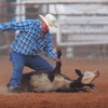 Cowboy Bradley Hamilton gets his rope around a calf during the calf roping competition Saturday night at the Norman Roundup Club's rodeo.<br /> Kyle Phillips/The Transcript