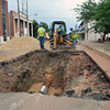 Workers from the City of Norman's Wastewater Management crew prepare to refill a hole in Peters Ave. just south of Main Street Thursday afternoon after they repaired a break in a water main under the road.<br /> Kyle Phillips/The Transcript