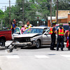 Emergency crews investigate an accident on Peters St. Friday afternoon.  According to Norman police, a pickup was heading south on Peters when it was struck by westbound Crown Victoria that failed to stop at a red light. <br /> Minor injuries were reported related to the deployment of the airbag in the Crown Victoria. <br /> Kyle Phillips/The Transcript
