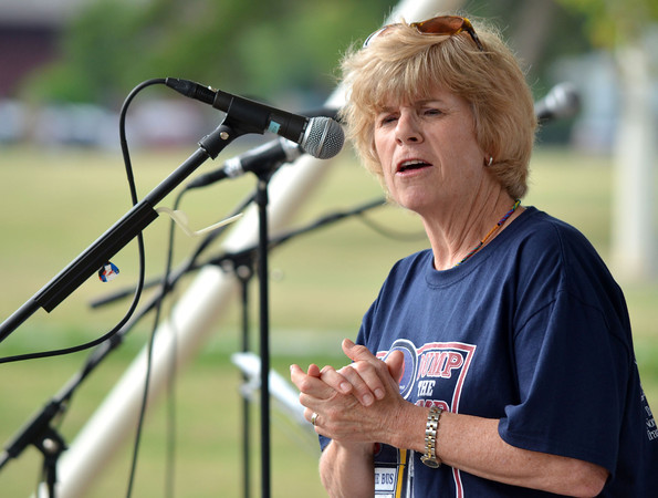 Norman Mayor Cindy Rosenthal talks to the crowd at the Dump the Pump event Thursday evening at Andrews Park.  Rosenthal emphensized the fact that riding CART helps motorist save money and is a good way to helo the enviroment.<br /> Kyle Phillips/The Transcript