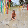 Autumn Walker plays at the Andrews Park splash pad Wednesday afternoon to get some relief from the Summer heat. Summer officially kicks off Wednesday, with the solstice marking the longest day of the year in the Northern Hemisphere.<br /> Kyle Phillips/The Transcript