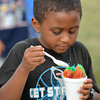 Kobe Baidoo eats his free snow cone Thursday evening at Andrews Park during the Dump the Pump event.  The event included a free concert featuring the band zero2sixty, giveaways and free CART transportation.<br /> Kyle Phillips/The Transcript