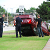 Norman police officers investigate a single-vehicle accident on 24th Ave. NW just south of Robinson St. early Friday evening.  The car flipped over after jumping the curb and running over a fire hydrant.  Paramedics were called to the scene but no one was injured in the accident.<br /> Kyle Phillips/The Transcript