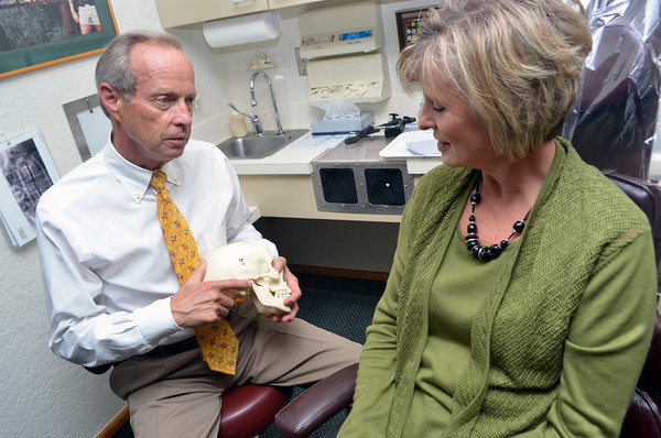 Dr. Robert Talley, left, talks with a patient about options during an office visit at his practice.<br /> Kyle Phillips/The Transcript
