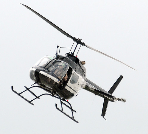 The Oklahoma Highway Patrol helicopter assisted Norman Police Dept. Friday, June 22, 2012, in a manhunt for burglary suspects in west Norman.  Jerry Laizure / The Transcript