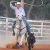 Cowboy Steve Brewer gets his rope around a calf during the calf roping competition Saturday night at the Norman Roundup Club's rodeo.<br /> Kyle Phillips/The Transcript
