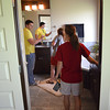 Kellen Powell, left, and Corrie Bober check out the bathroom at the Festival Show Home at the Festival of Homes Saturday afternoon.<br /> Kyle Phillips/The Transcript