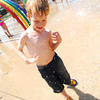 Rewdan Tucci, 6, plays at the Andrews Park Splash Pad Saturday afternoon to beat the Summer heat.  Many people took advantage of the warm weather yesterday after a cooler Friday evening had many in warmer clothes.<br /> Kyle Phillips/The Transcript