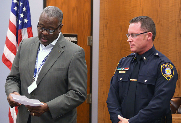 Norman Chief of Police Keith Humphrey, left, congratulates Jeffrey Robertson for his promotion from sergeant to lieutenant Friday afternoon during Robertson's promotion ceremony at the municiple court room.<br /> Kyle Phillips/The Transcript