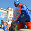 An Oklahoma City Thunder super hero stands on a ledge as people in Thunder Alley take pictures before the start of the Thunder's game against Miami at Chesapeake Energy Arena Tuesday evening.<br /> Kyle Phillips/The Transcript