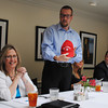 "Incoming Norman Convention and Visitors Bureau Board of Directors chair, Kris Glenn accepts a hat reflecting his desire to stay ""neutral, like Switzerland."" The comment came in earlier debates over positions the NCVB Board took on city policy. Transcript Photo by Joy Hampton"
