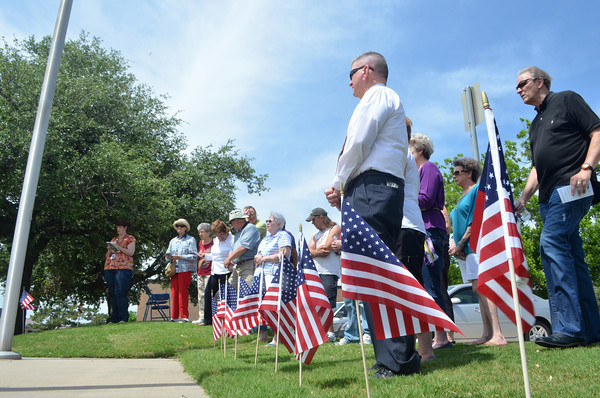 People gather around the flagpole at the City of Norman Complex Thursday morning to pray for our national and local leaders during the National Day of Prayer.<br /> Kyle Phillips/The Transcript
