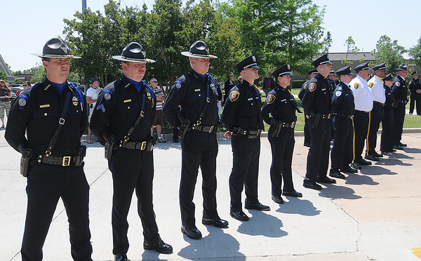 An honor guard made up of members of the Norman Police Dept., Norman Fire Dept., EMSSTAT, OU Police Dept. and Cleveland County Sheriff's Office was on hand Friday, May 18, 2012, during the 2012 Law Enforcement Memorial Service at the fallen officer memorial in front of the Norman Police Department. Photo by Jerry Laizure