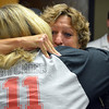 Norman Police Sgt. Teresa Roberts hugs dispatcher Carolyn Glover during Roberts' retirement party at the police station Thursday morning.  Roberts, who grew up in Norman, is the longest serving female Norman police officer and is retiring after 35 years of service.<br /> Kyle Phillips/The Transcript