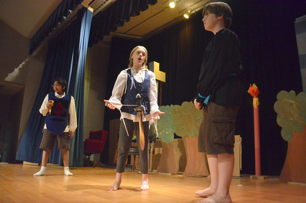 """Students from McKinley Elementary School go over thier lines for the play """"Romeo and Juliet Wednesday afternoon at the school.<br /> Transcript Photo by Kyle Phillips"""