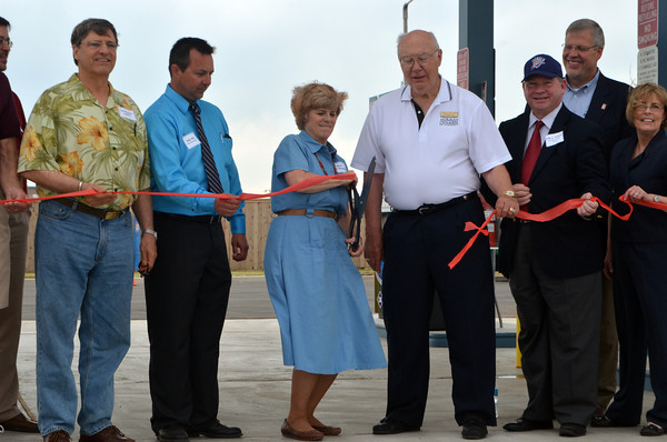 Norman Mayor Cindy Rosenthal cuts the ribbon at the official opening of Norman's compressed natural gas station Friday afternoon.<br /> Kyle Phillips/The Transcript
