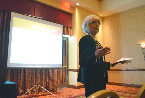 "Carol Hager talks with visitors at the 37th Annual Oklahoma Conference on Aging ""Secrets of Aging: Hidden Treasures"" about how to deal with the financial aspect of family loss Wednesday at the Embassy Suites.<br /> Kyle Phillips/The Transcript"