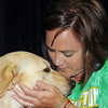 Wahington Elementary School teacher Amber Bui sits with therapy dog Sunshine Monday, May 21, 2012, during an assembly in which Bui, Sunshine's  owner announced that the dog would be used in Washington classrooms next year. Jerry Laizure/The Transcript