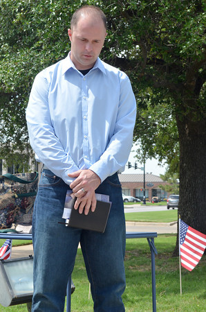 Chad William, Administrative Pastor at Harvest Church, leads people in the Lord's Prayer Thursday morning  City of Norman Complex during the National Day of Prayer.<br /> Kyle Phillips/The Transcript