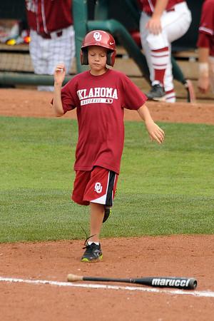 Oklahoma batboy Cason Dillon Sunday, May 6, 2012, at Bricktown Ballpark during the third game of the Bedlam series.. Photo by Jerry Laizure