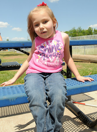 Hailey Baskeyfield, a child in Janet Whitworth's class at Jackson Elementary School, is competing in a national braille competition. She is posing in Rotary Park, Tuesday, May 8, 2012,. Photo by Jerry Laizure