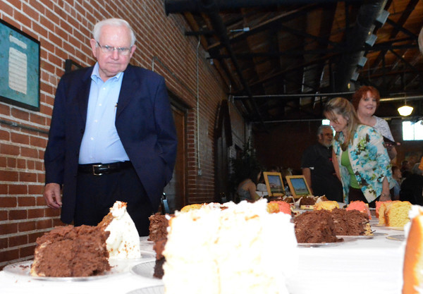 Jerry Master looks at the dessert table  at Mission Norman's fundraising event at the Hall at Old Town Plaza Thursday evening.  The organization is holdong the first annual event in order to raise money for Mission Norman.  The quilts for the event were donated by Judy Howard.<br /> Kyle Phillips/The Transcript