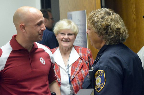 Norman Police Sgt. Teresa Roberts, right,  talks with Det. Thomas Laird during her retirement party at the police station Thursday morning.  Roberts, who grew up in Norman, is the longest serving female Norman police officer and is retiring after 35 years of service.<br /> Kyle Phillips/The Transcript