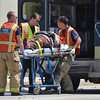 Norman paramedics load up an accident victim as they respond to a two-vehicle wreck on 36th Avenue NW just north of the Robinson Street intersection.  According to Norman Police Capt. Tom Easley the preliminary investigation indicates the southbound vehicle, driven by a motorist with a learners permit, tried to make a left hand turn and in the process collided head-on with a vehicle travelling northbound on 36th Avenue NW.  Two people were taken to the hospital with non-life thretening injuries.  The driver of the southbound vehicke was cited for failure to yield while making a turn.<br /> Kyle Phillips/The Transcript