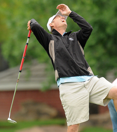 Mark Tekell reacts to sinking a putt  Monday, May 7, 2012, during the Norman Board of Realtors golf tournament at the Trails. The annual tournament is a fundraiser for area schools. Photo by Jerry Laizure