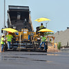 Workers unload asphalt from a truck as they continue working on the parking lot at the Cleveland County Fairgrounds Wednesday afternoon.<br /> The project, which is a full county project with the City of Norman helping with the asphalt portion, should be complete by this weekend according to Cleveland County Commissioner Rod Cleveland.