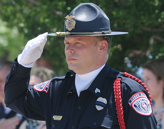 OU police offcer  John Bishop salutes Friday, May 18, 2012, during the singng of the National Anthem at the 2012 Law Enforcement Memorial Service at the fallen officer memorial in front of the Norman Police Department. Photo by Jerry Laizure