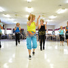 Maria Grey, middle, leads the Zingers in a dance as they perform for the residents at the Cedar Creek Nursing Center Friday afternoon.  The is the group's second performance and they are hoping to expand their show to other assisted living centers in the future.<br /> Kyle Phillips/The Transcript