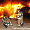 Norman firefighters prepare to attack at an early morning house fire Saturday Dec. 17, 2011, at 1316 Sunset Drive. The house was fully involved when firefighters arrived at the house around 12:15 a.m.  Photo by Jerry Laizure