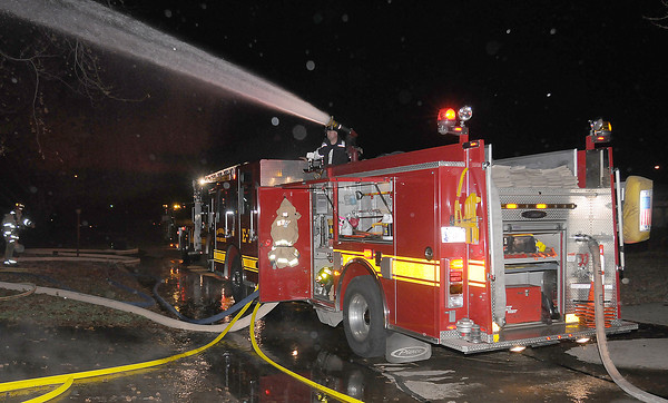 Engine 7's deck gun pours water on an early morning house fire Saturday Dec. 17, 2011, at 1316 Sunset Drive. The house was fully involved when firefighters arrived at the house around 12:15 a.m.  Photo by Jerry Laizure