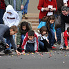 Children gather to collect candy and other treats that are tossed during the Norman Christmas Parade on Saturday. Julie Bragg/ For the Transcript