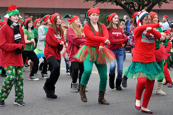 """Preformers from the Alcott Drama team spoofs the Internet sensation dance """"Gangnam Style"""" during the Norman Christmas Parade on Saturday. Julie Bragg/ For the Transcript"""